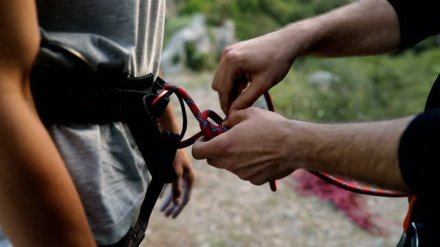 preparing for free climbing - rock climbing stock videos & royalty-free footage