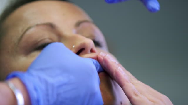 preparing for lip injection - inserting stock videos & royalty-free footage