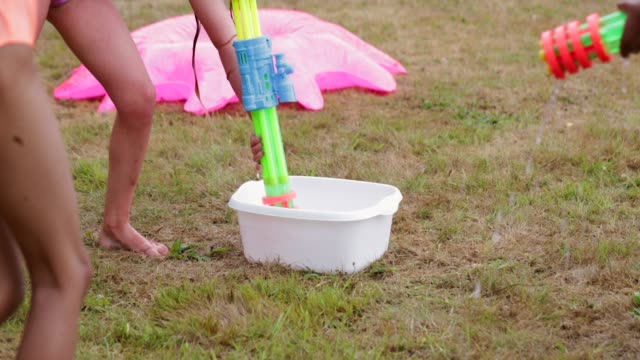 preparing for the water gun fight - water fight stock videos & royalty-free footage