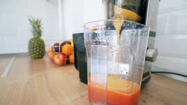 preparing fresh smoothie. - electric juicer stock videos & royalty-free footage