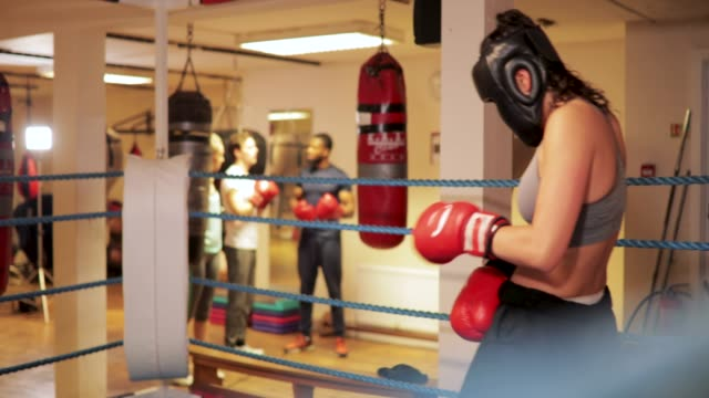 preparing gloves for boxing - boxing women's stock videos & royalty-free footage