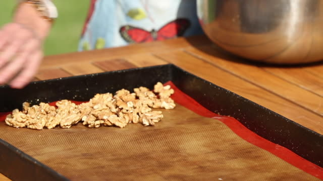 preparing granola with almonds nuts and pistachios