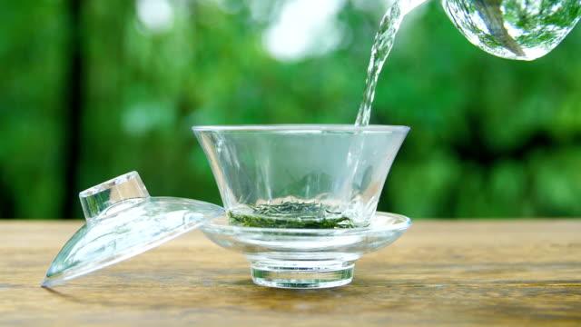 preparing green tea in the nature - preparing food stock videos & royalty-free footage