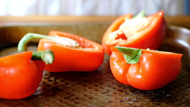 preparing halved red bell pepper for roasting - red bell pepper stock videos & royalty-free footage