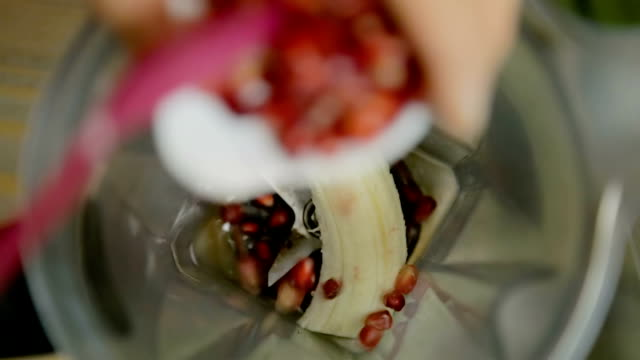 preparing healthy smoothie in blender with banana and pomegranate seed - juice extractor stock videos & royalty-free footage