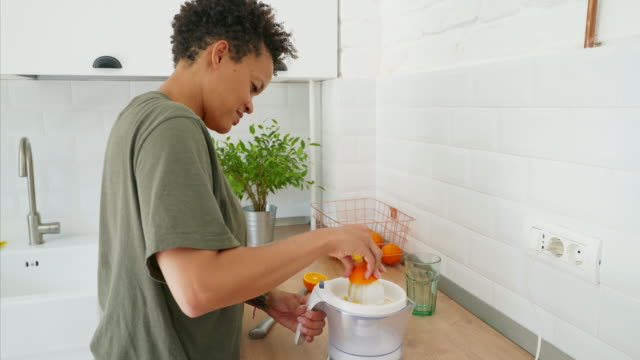 preparing her favorite juice. - electric juicer stock videos & royalty-free footage
