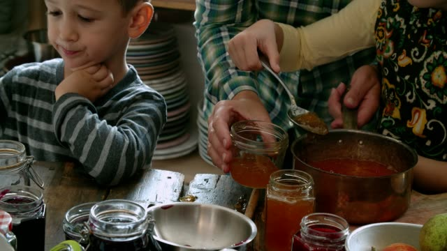 Preparing Homemade Apricot Jam and Canning in Jars