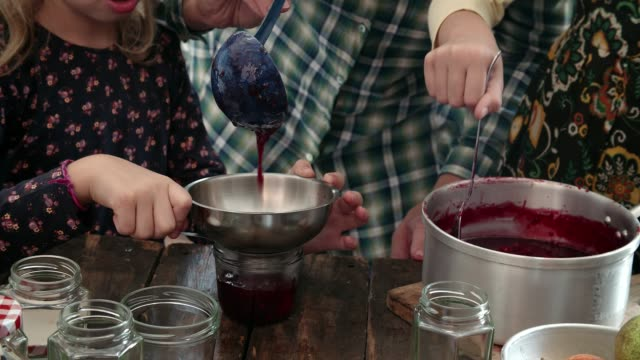 preparing homemade berry jam and canning in jars - food state stock videos & royalty-free footage