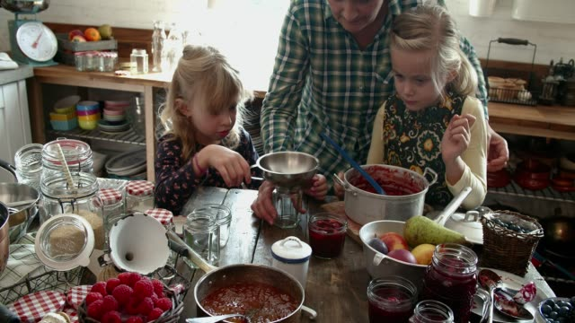 preparing homemade berry jam and canning in jars - canning stock videos & royalty-free footage