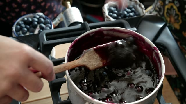 preparing homemade blueberry jam and canning in jars - food state stock videos & royalty-free footage
