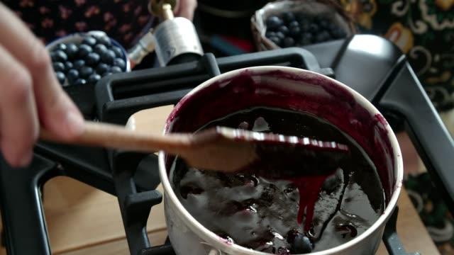 preparing homemade blueberry jam and canning in jars - preserve stock videos and b-roll footage