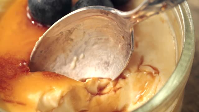 preparing homemade creme brulee with berries - custard stock videos & royalty-free footage