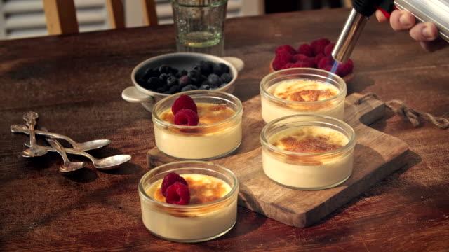 preparing homemade creme brulee with berries - spoon stock videos & royalty-free footage