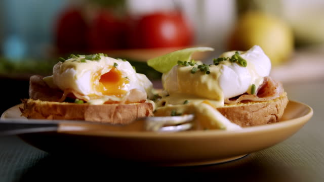 preparing homemade eggs benedict in the domestic kitchen - egg yolk stock videos & royalty-free footage
