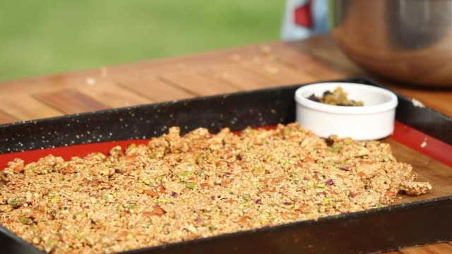 preparing homemade granola with yogurt - pistachio nut stock videos & royalty-free footage