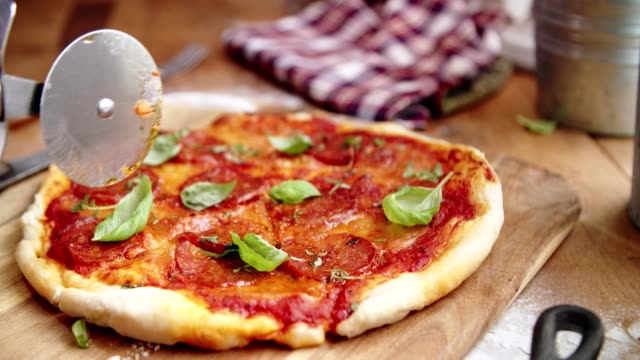 preparing homemade pan pizza in domestic kitchen - slice stock videos and b-roll footage