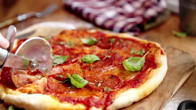preparing homemade pan pizza in domestic kitchen - slice stock videos & royalty-free footage