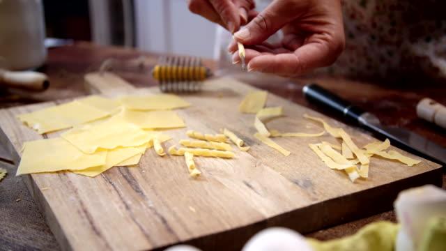 preparing homemade pasta - pasta machine stock videos and b-roll footage