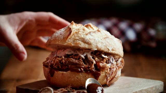 preparing homemade pulled pork burger in domestic kitchen - comfort food stock videos & royalty-free footage