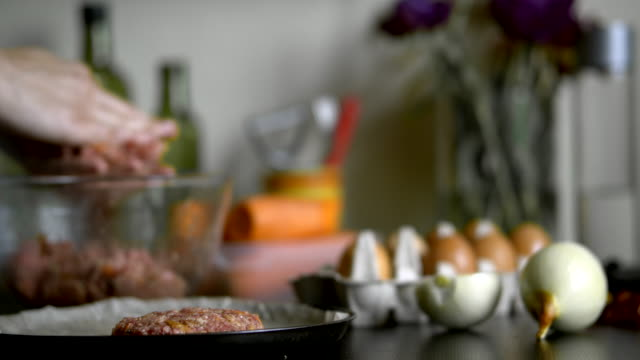 preparing homemade roasted nests of minced meat and eggs - bird's nest stock videos & royalty-free footage