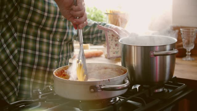 preparing homemade spaghetti bolognese - sauce stock videos & royalty-free footage