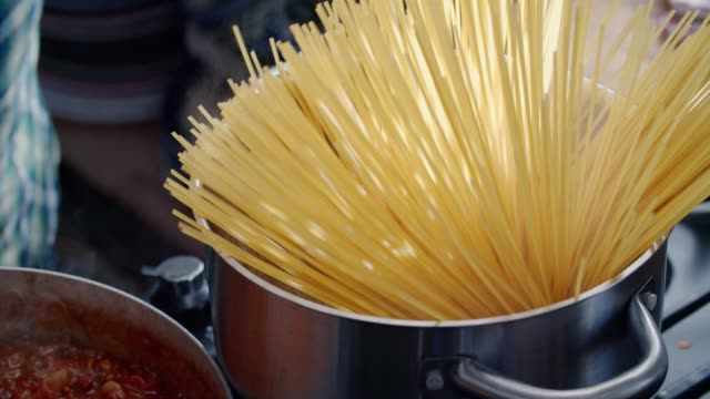 preparing homemade spaghetti bolognese - noodles stock videos and b-roll footage