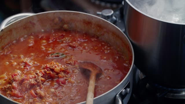 preparing homemade spaghetti bolognese - italian food stock videos and b-roll footage