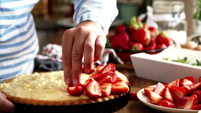 preparing homemade strawberry cake with pudding and fresh strawberries - tart dessert stock videos & royalty-free footage