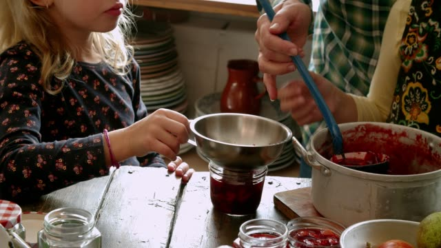 preparing homemade strawberry jam and canning in jars - strawberry jam stock videos & royalty-free footage