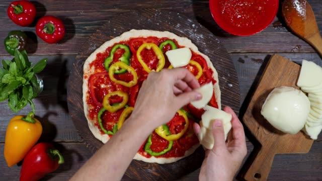 preparing homemade vegetarian pizza - mozzarella stock videos & royalty-free footage