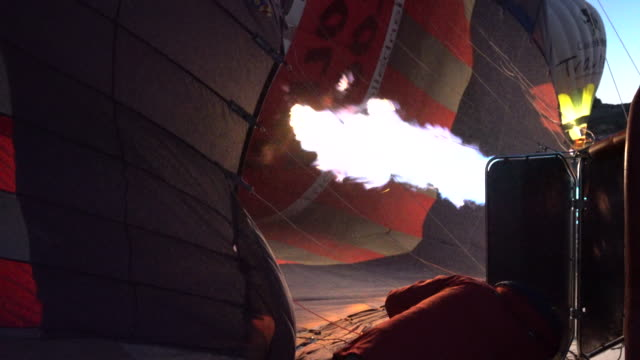 preparing hot air balloons to fly in cappadocia - cappadocia stock videos and b-roll footage