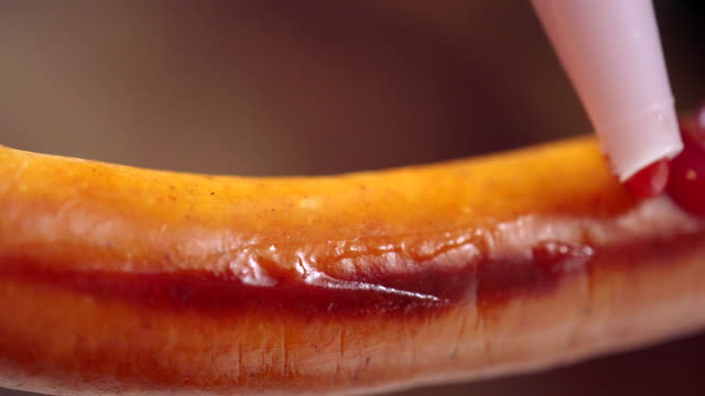 preparing hot dog with mustard and ketchup - mustard stock videos and b-roll footage