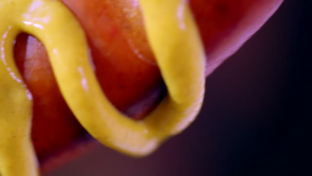 preparing hot dog with mustard and ketchup - mustard stock videos & royalty-free footage