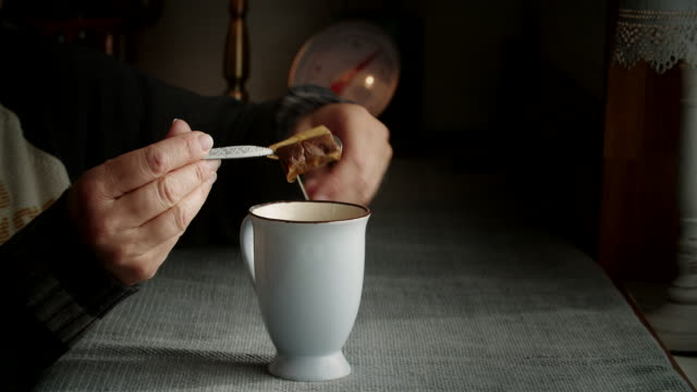 preparing hot herbal tea into a cup - black tea stock videos & royalty-free footage