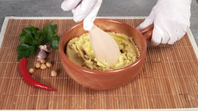 preparing hummus with olive oil - appetizer stock videos & royalty-free footage