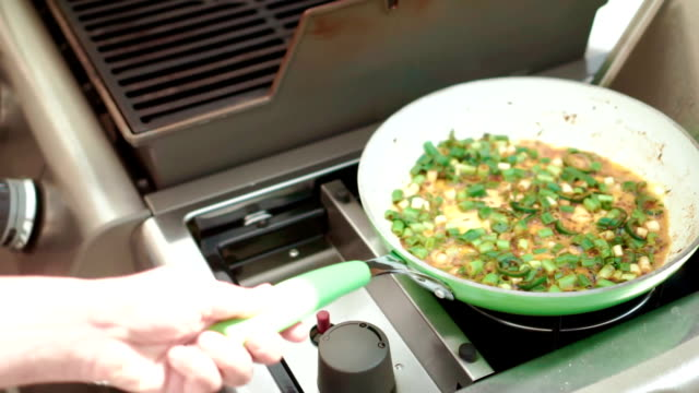 preparing indian masala fried egg - cilantro stock videos and b-roll footage