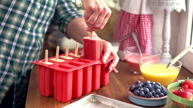preparing mango, strawberry, blueberry, yogurt ice cream on stick - frost stock videos & royalty-free footage