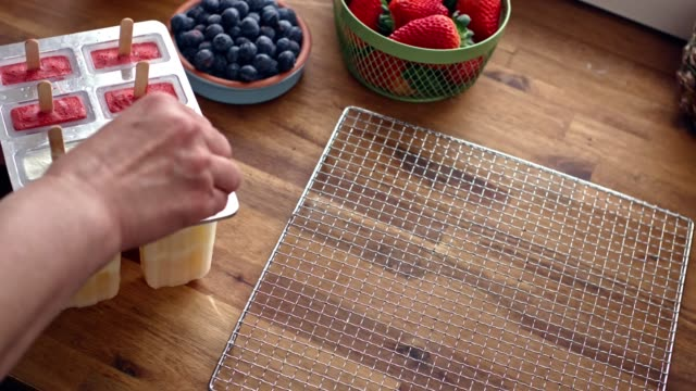 preparing mango, strawberry, blueberry, yogurt ice cream on stick - popsicle stick stock videos and b-roll footage