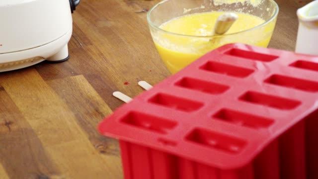 preparing mango, strawberry, chocolate, yogurt ice cream on stick - popsicle stick stock videos and b-roll footage
