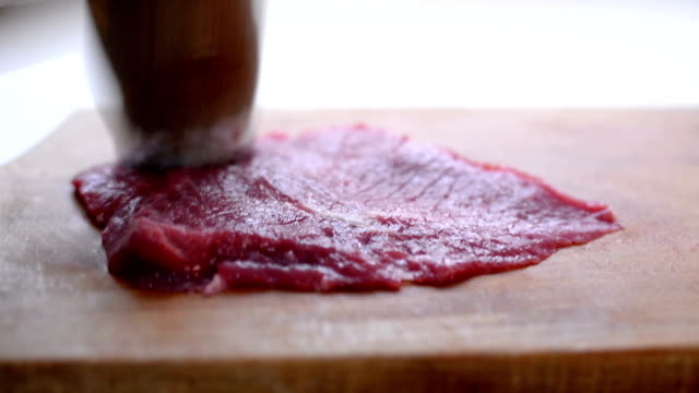 preparing meat. close up - batting stock videos & royalty-free footage