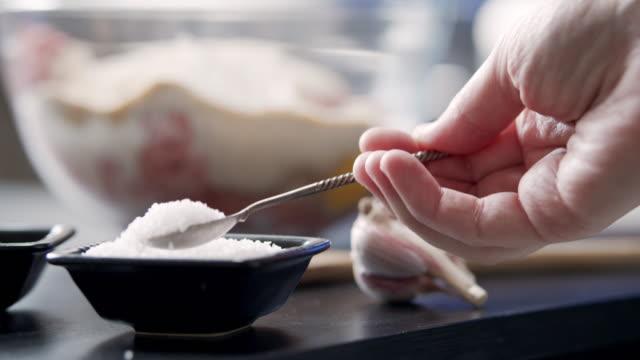 preparing meat loaf - adding salt stock videos & royalty-free footage
