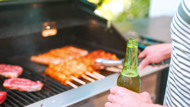 Preparing meat on barbecue grill