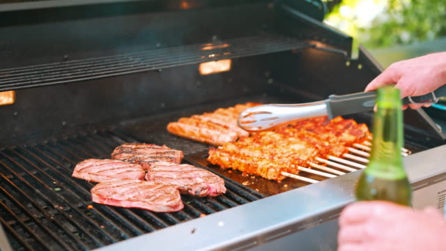 preparing meat on barbecue grill - barbecue grill stock videos and b-roll footage