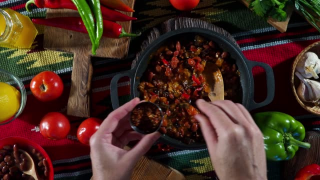 preparing chili sin carne - sprinkling stock videos and b-roll footage