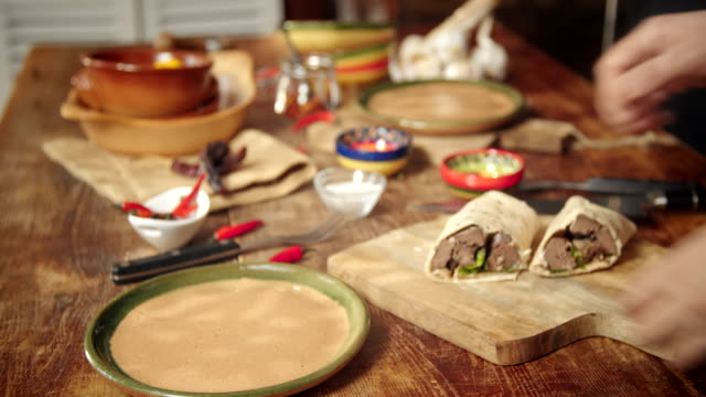 preparing mexican wraps with spicy beef and sour cream - sour cream stock videos and b-roll footage