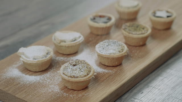 preparing  mince pie for christmas party in the kitchen - christmas decoration stock videos & royalty-free footage