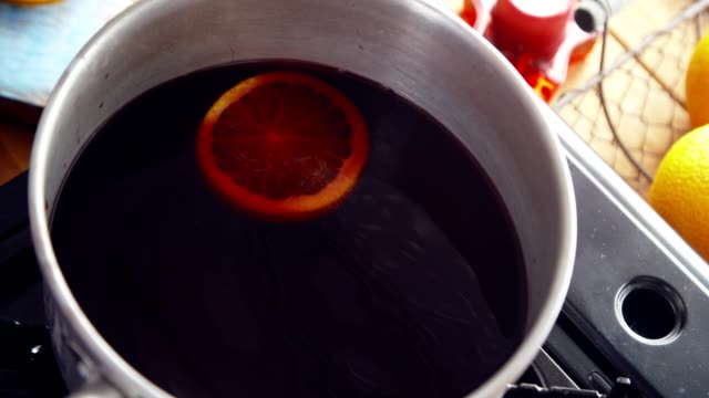 preparing mulled wine with orange, cinnamon, star anise and spices for christmas - star anise stock videos and b-roll footage
