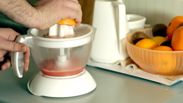 preparing natural grapefruit juice - squeezing stock videos & royalty-free footage