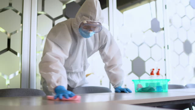preparing office after pandemic - cleaner stock videos & royalty-free footage