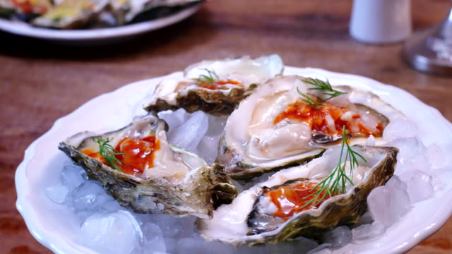 preparing oyster dish - oyster shell stock videos & royalty-free footage